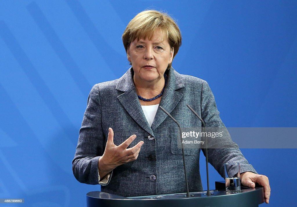 Merkel And Feymann Discuss Migrants Crisis : News Photo