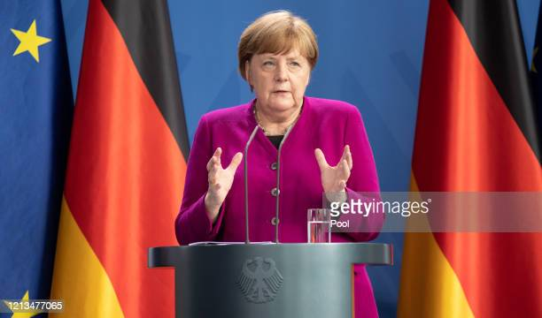 German Chancellor Angela Merkel speaks to the media at the Chancellery at a joint press conference with French President Emmanuel Macron during the...