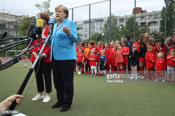German Chancellor Angela Merkel speaks to the media at the conclusion of her visit to a program to encourage integration of children with foreign...