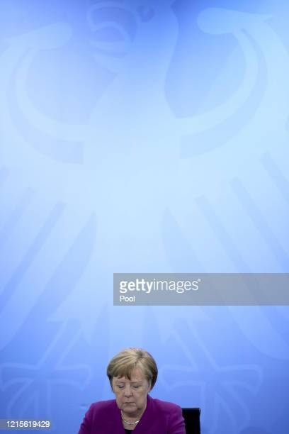 German Chancellor Angela Merkel speaks to the media following a teleconferenced meeting with leaders of Germany's eastern states during the...