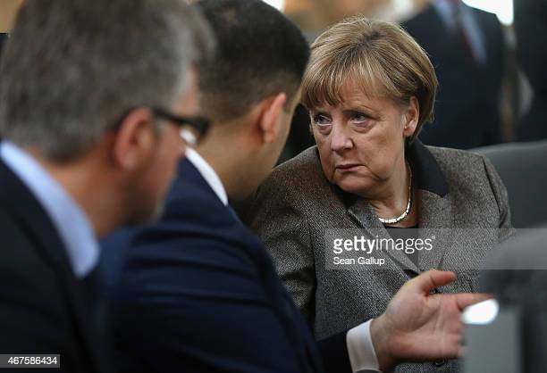 German Chancellor Angela Merkel speaks to Volodymyr Groysman Chariman of the Ukrainian Verkhovna Rada the Ukrainian parliament during debates at the...