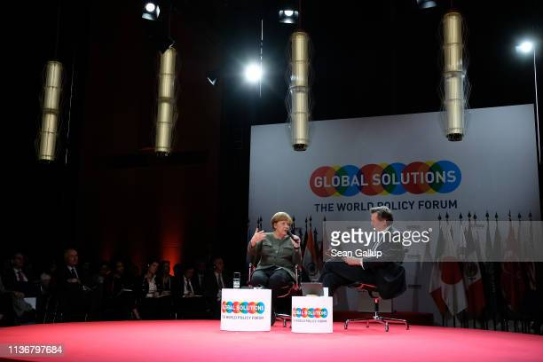 German Chancellor Angela Merkel speaks with Bloomberg EditorinChief John Mickelthwait at the Global Solutions Summit on March 19 2019 in Berlin...