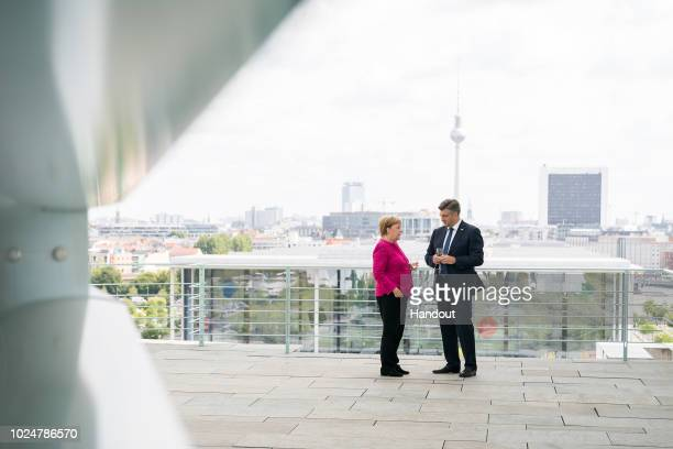 German Chancellor Angela Merkel speaks with Croatian Prime Minister Andrej Plenkovic on the balcony of the Federal Chancellery on August 28 2018 in...