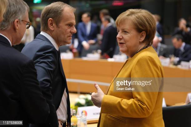 German Chancellor Angela Merkel speaks with European Council President Donald Tusk on the second day of an EU summit on March 22, 2019 in Brussels,...