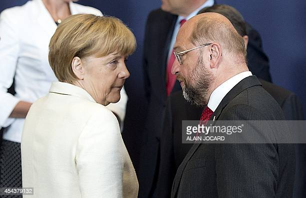 German Chancellor Angela Merkel speaks with European Parliament president Martin Schulz before posing for a family picture during a European Union...