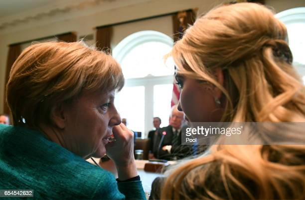 German Chancellor Angela Merkel speaks with Ivanka Trump during a roundtable discussion on vocational training with United States and German business...
