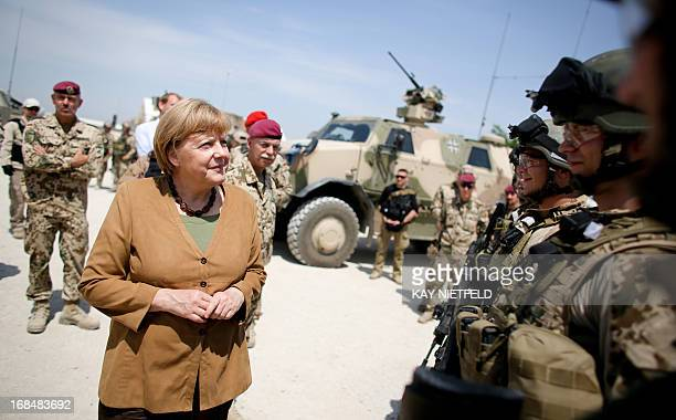 German Chancellor Angela Merkel speaks with soldiers of the German armed forces Bundeswehr during her visit on May 10 2013 at the Bundeswehr base in...