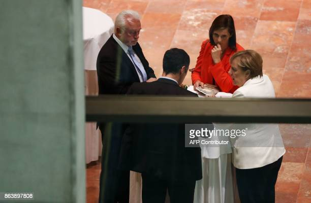 German Chancellor Angela Merkel speaks with the co-leaders of the Germany Greens Party Cem Ozdemir and Katrin Goering-Eckardt and Wolfgang Kubicki ,...
