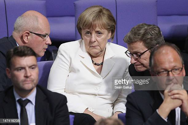 German Chancellor Angela Merkel speaks with Volker Kauder head of the Bundestag faction of the German Christian Democrats and Foreign Minister Guido...