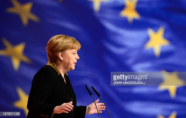 German Chancellor Angela Merkel stand in front of a flag of Europe as she speaks during a congress of Germany's ruling conservative Christian...