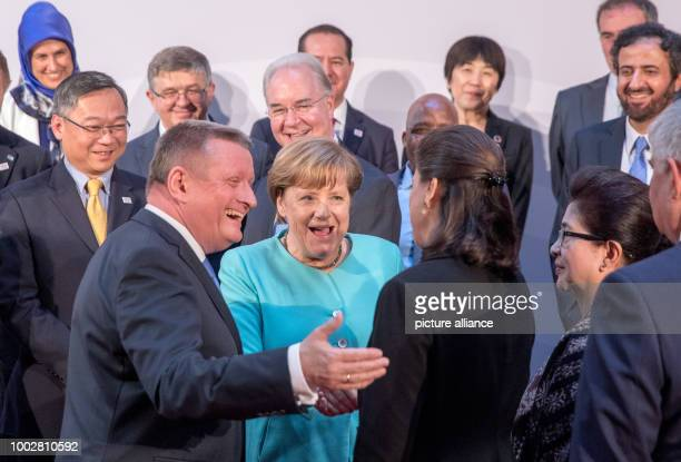 German Chancellor Angela Merkel standing next to Federal Health Minister Hermann Grohe greets the new French Health Minister Agnès Buzyn during the...