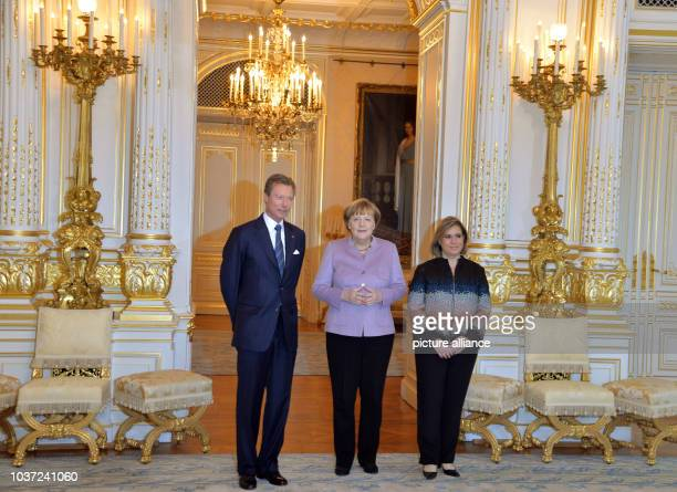 German Chancellor Angela Merkel standing with Grand Duke Henri and Grand Duchess Maria Teresa of Luxembourg in the Grand Ducal palace in Luxembourg,...