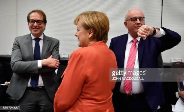 German Chancellor Angela Merkel stands inbetween German Transport Minister Alexander Dobrindt and Parliamentary group leader of the conservative...