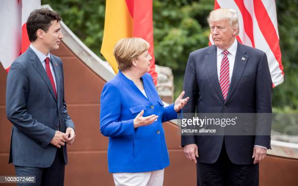 German Chancellor Angela Merkel stands next to US President Donald Trump and Canada's Prime Minister Justin Trudeau during the 'family portrait' at...