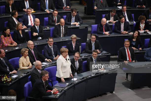 German Chancellor Angela Merkel stands to accept her renewed mandate following her election by the Bundestag for a fourth term as chancellor on March...