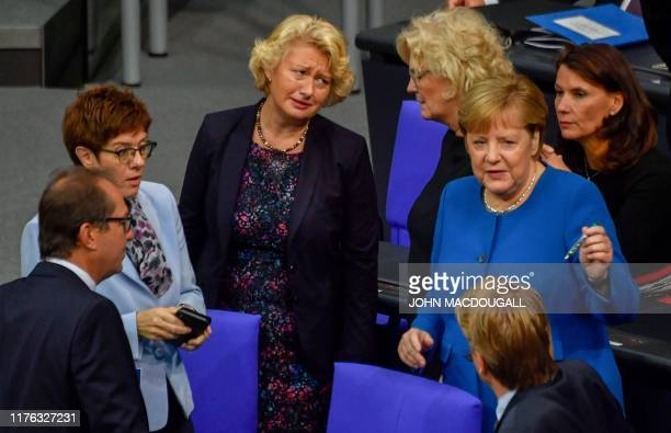 German Chancellor Angela Merkel stands with the leader of the Christian Democratic Union and Defence Minister Annegret KrampKarrenbauer the deputy...