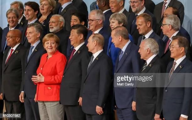 German Chancellor Angela Merkel stands with the other G20 leaders as they pose for a family photo during the G20 summit on July 7 2017 in Hamburg...