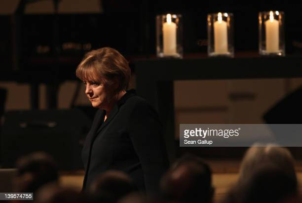 German Chancellor Angela Merkel steps down from the stage after speaking at a state commemoration for the victims of the NSU neoNazi murders at the...