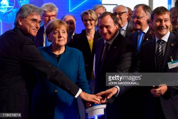 German Chancellor Angela Merkel Swedish Prime Minister Stefan Lofven Siemens CEO Joe Kaeser and member of the board of Siemens Klaus Helmrich press a...