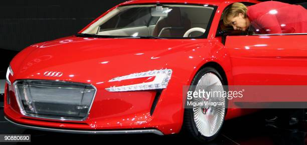 German Chancellor Angela Merkel takes a look at the Audi R8 ETron Concept car during the international motor show IAA on September 17 2009 in...