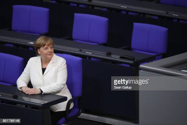 German Chancellor Angela Merkel takes a seat moments after she took her oath to serve her fourth term as chancellor following her election by the...