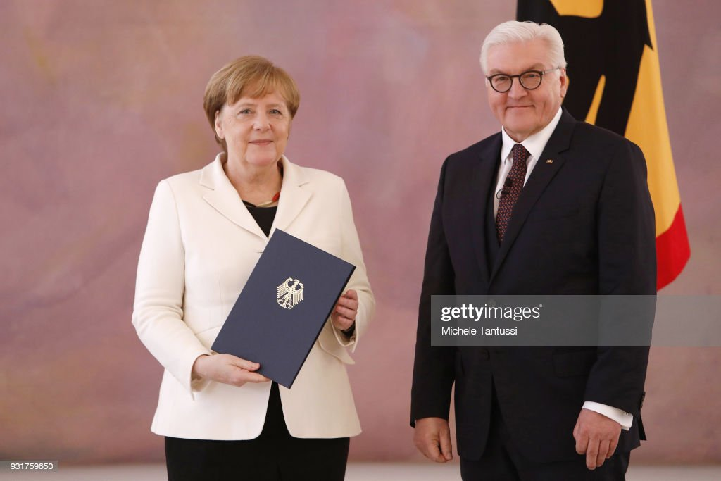 German Chancellor Angela Merkel takes her oath to serve her fourth term as chancellor with German President Frank-Walter Steinmeier, following her election by the Bundestag on March 14, 2018 in Berlin, Germany. Members of the new German government, a coalition between Christian Democrats (CDU/CSU) and Social Democrats (SPD), were sworn in today and will begin work immediately. The new government took the longest to create of any government in modern German history following elections last September that left the German Christian Democrats (CDU) as the strongest party but with too few votes in order to have a strong hand in determining the next coalition.
