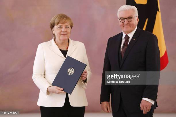 German Chancellor Angela Merkel takes her oath to serve her fourth term as chancellor with German President FrankWalter Steinmeier following her...