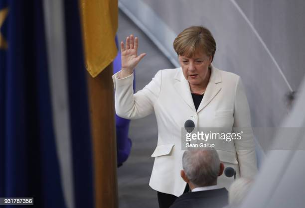German Chancellor Angela Merkel takes her oath to serve her fourth term as chancellor following her election by the Bundestag on March 14 2018 in...