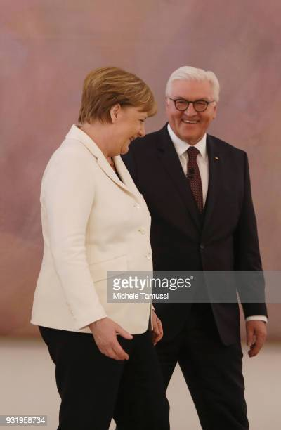 German Chancellor Angela Merkel takes her oath to serve her fourth term as chancellor from Germany State President FrankWalter Steinmeier following...