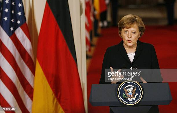 German Chancellor Angela Merkel takes part in a joint press conference with US President George W Bushin the East Room of the White House January 13...