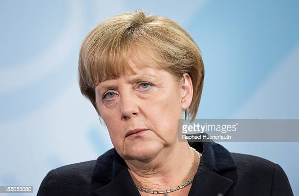 German Chancellor Angela Merkel talks during a joint press conference with Turkish Prime Minister Recep Tayyip Erdogan on October 31 2012 in Berlin...