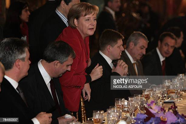 German Chancellor Angela Merkel talks during a lunch after she signed the ''Treaty of Lisbon'' in the Coche museum in Lisbon 13 December 2007 The...