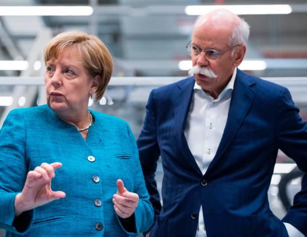 German Chancelor Angela Merkel and CEO of Daimler and ...