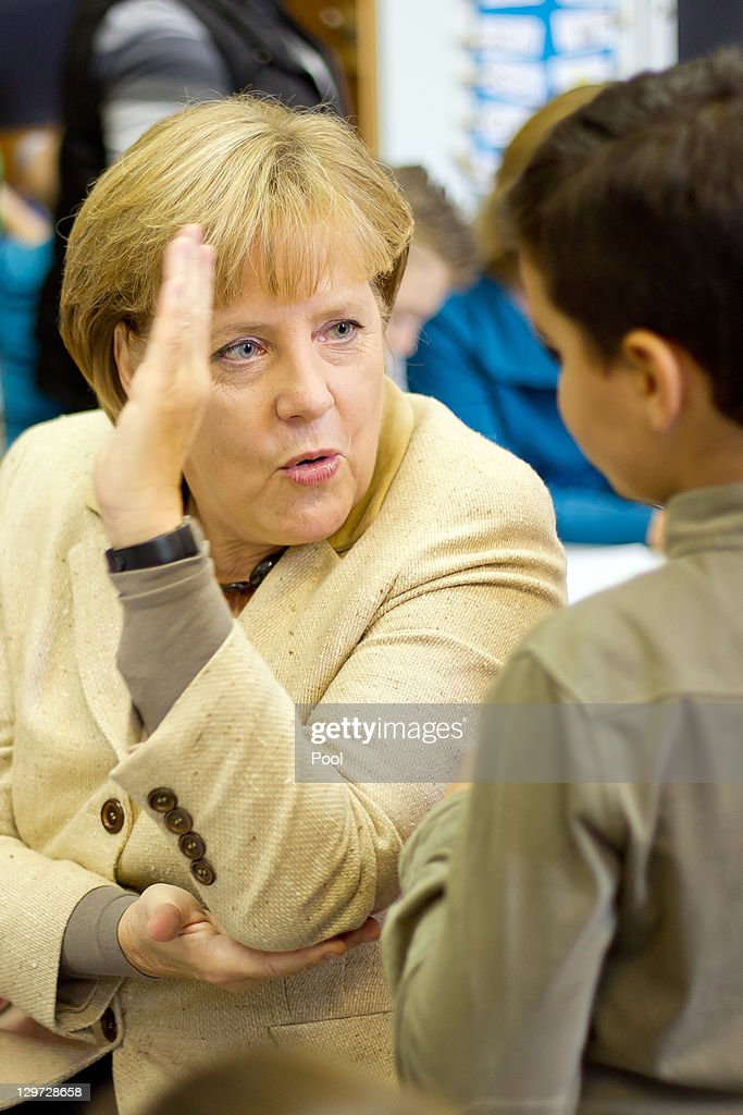 German Chancellor Angela Merkel Talks To Children During A Visit At News Photo Getty Images