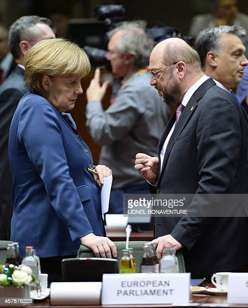 German Chancellor Angela Merkel talks to European Parliament President Martin Schulz during an EU summit focused on the common security Defence...