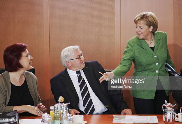 German Chancellor Angela Merkel talks to German Foreign Minister Frank-Walter Steinmeier and German Development Minister Heidemarie Wieczorek-Zeul at...