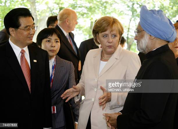 German Chancellor Angela Merkel talks to Indian Prime Minister Manmohan Singh and Chinese President Hu Jintao at the beginning of a working session...