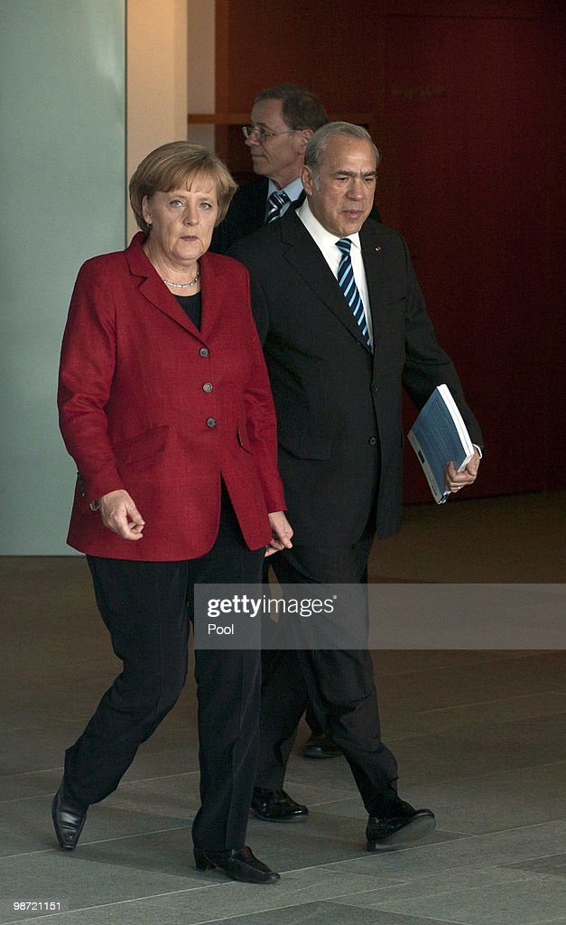 German Chancellor Angela Merkel (L) talks to OECD Secretary-General Jose Angel Gurria during the handover of the OECD Report at the Chancellery on April 28, 2010 in Berlin, Germany. Merkel met with International Organizations to discuss a solution for the Greece debt crisis that is intensifying pressure on policy makers to widen a bailout package beyond Greece after the Greek debt rating was decreased to 'junk' status. Newsmakers report that the 45 billion euros ($60 billion) already pledged by the International Monetary Fund and European Union will be insufficient to tackle Greece's mounting debt crisis.