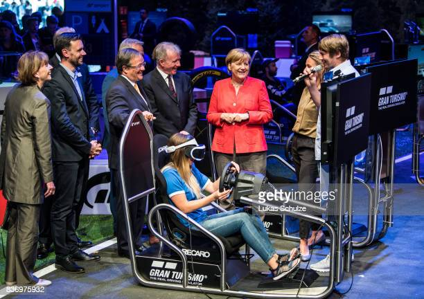 German Chancellor Angela Merkel talks to people of Sony while visiting the Gamescom 2017 video gaming trade fair on August 22 2017 in Cologne Germany...