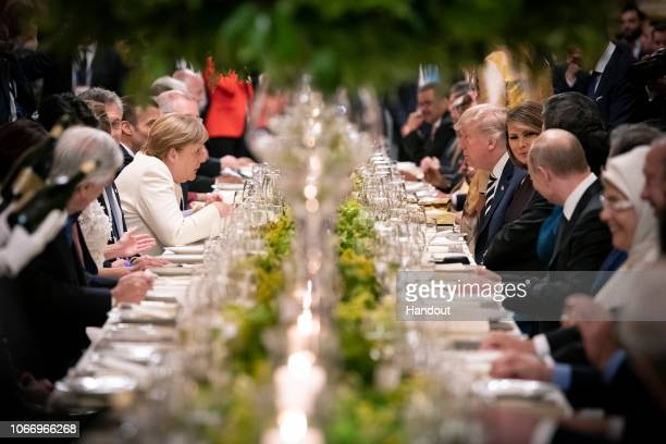 German Chancellor Angela Merkel talks to US President Donald Trump during the dinner for the participants and partners of the G20 Summit at the Colon...
