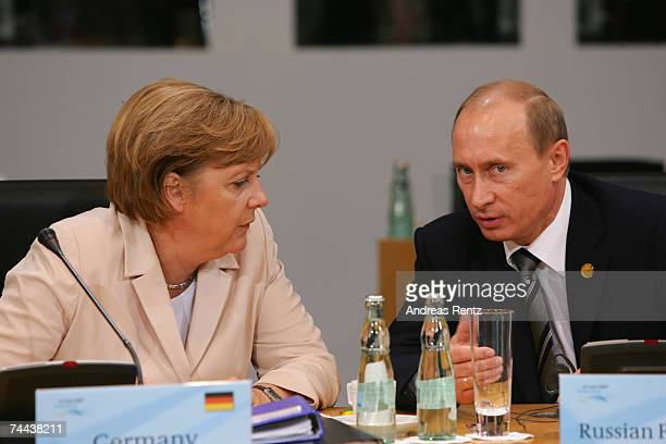 German Chancellor Angela Merkel talks to Wladimir Putin President of Russia prior to a working session of the G8 leaders and five top developing and...