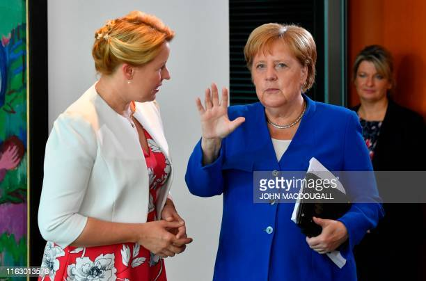 German Chancellor Angela Merkel talks with German Family Minister Franziska Giffey as they arrive for the weekly cabinet meeting on August 21 2019 at...