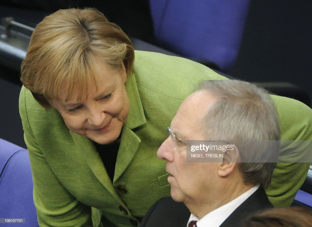 German Chancellor Angela Merkel talks with German Finance Minister Wolfgang Schaeuble during a debate at the Bundestag, the lower house of parliament, on May 21, 2010 in Berlin. The German parliament is set to unblock its share of a trillion-dollar rescue package for debt-stricken eurozone countries , after Chancellor Angela Merkel warned the euro was 'in danger'.