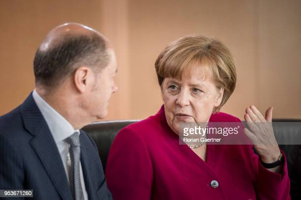 German Chancellor Angela Merkel talks with German Finance Minister Olaf Scholz before the weekly cabinet meeting at the chancellery on May 02 2018 in...