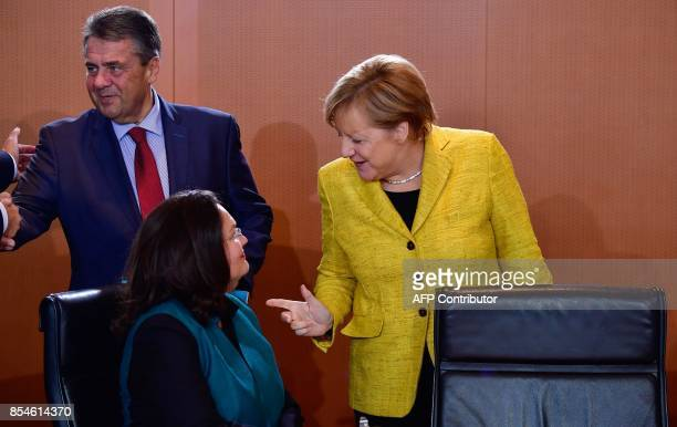 German Chancellor Angela Merkel talks with German Labour and Social Minister Andrea Nahles as German Vice Chancellor and Foreign Minister Sigmar...