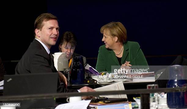 German Chancellor Angela Merkel talks with her advisor Beate Baumann and her spokesman Steffen Seibert on November 15 2011 in Leipzig eastern Germany...