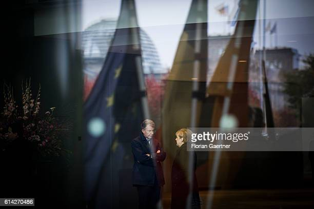 German Chancellor Angela Merkel talks with her consultant Christoph Heusgen before she receives the President of Chad on October 12 2016 in Berlin...