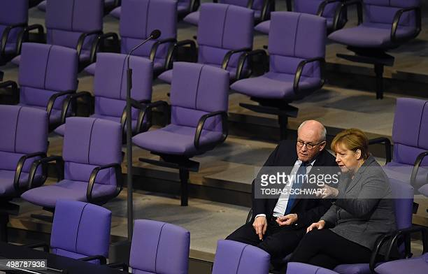 German Chancellor Angela Merkel talks with parliamentary group leader of the conservative Christian Democratic Union party Volker Kauder before a...