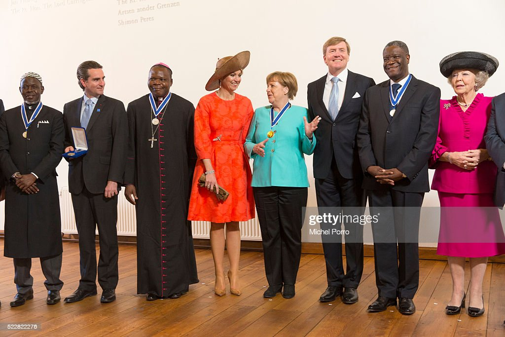 German Chancellor Angela Merkel (C) talks with Queen Maxima of The Netherlands and King Willem-Alexander of The Netherlands during a group photo with other laureates of the Four Freedoms Awards on April 21, 2016 in Middelburg Netherlands.