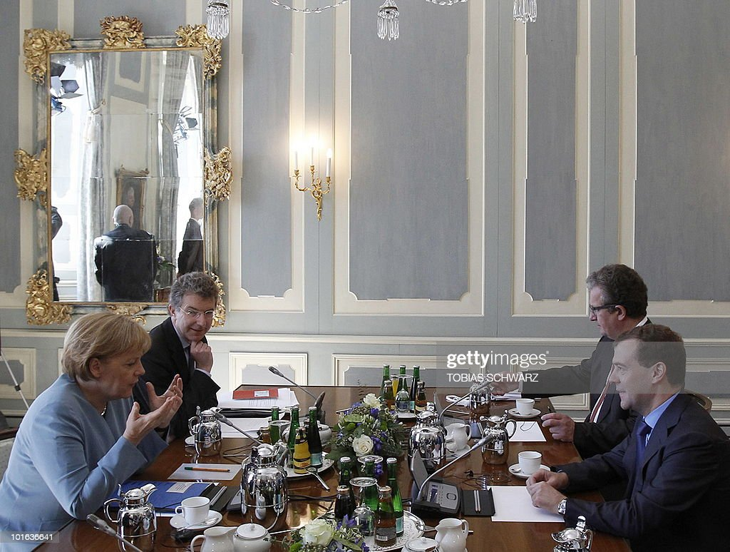 German Chancellor Angela Merkel (L) talks with Russian President Dmitry Medvedev (R) before bilateral talks at the government guest house Schloss Meseberg, some 70 kilometres (43.5 miles) north of Berlin, June 5, 2010. Medvedev is in Germany for two days of what the German government called 'informal' discussions set to be dominated by Iran's nuclear programme and the Middle East.